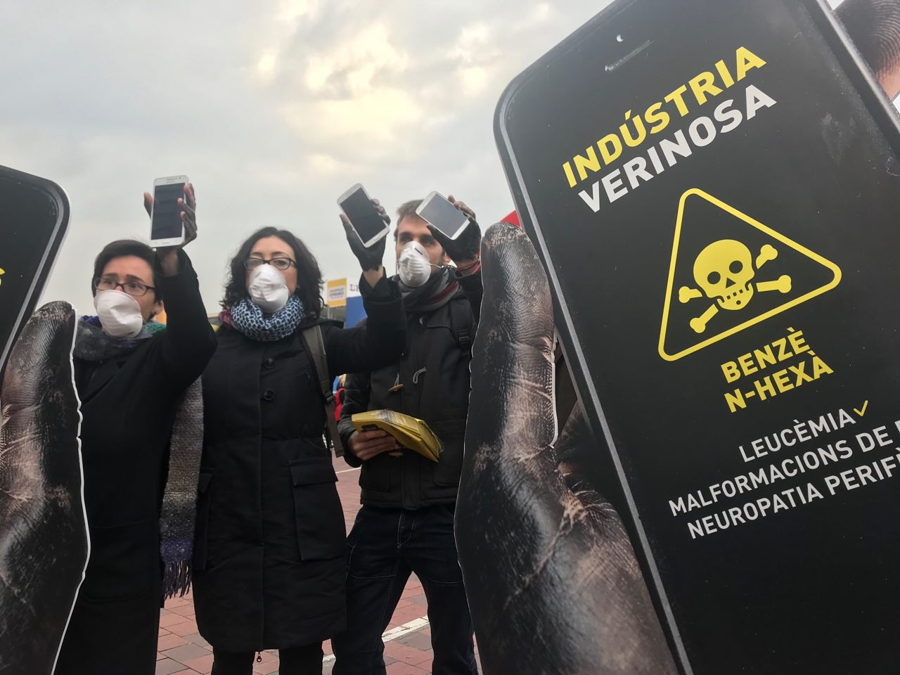SETEM activists protest the use of toxic chemicals in mobile phones at the MWC